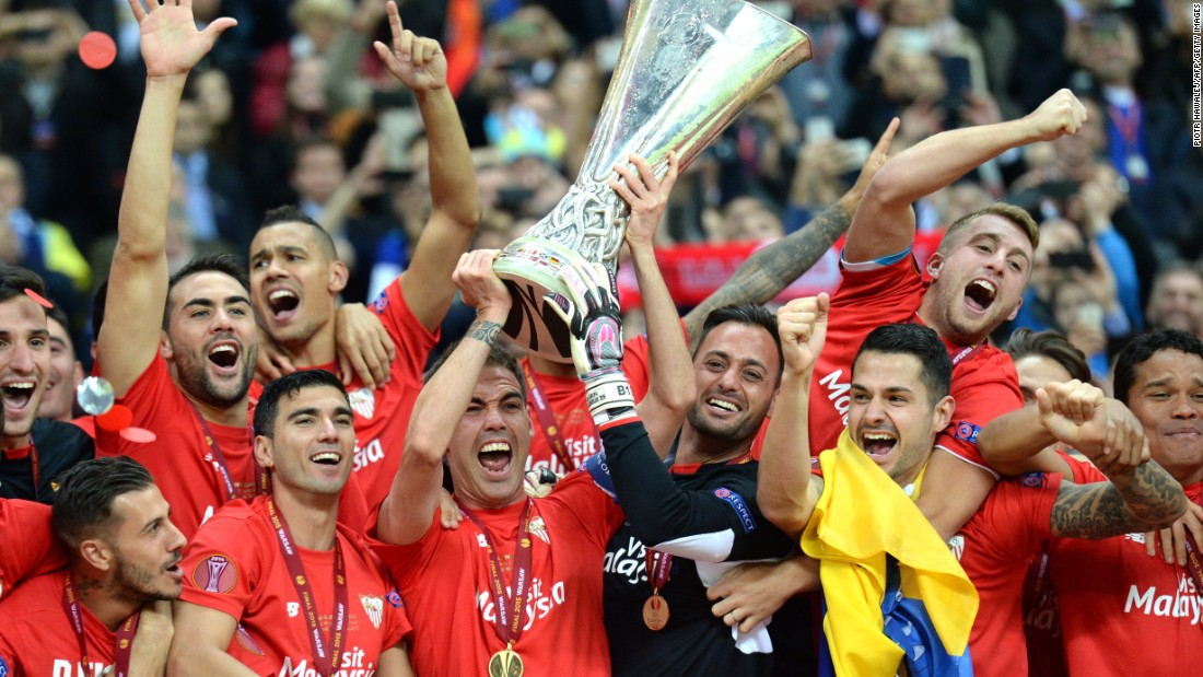 Sevilla players celebrate after a record fourth victory in UEFA's second-tier competition, beating Dnipro Dnipropetrovsk in the Europa League final in Warsaw.