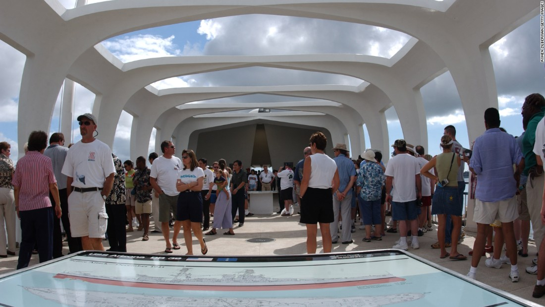 Visitors pay their respects aboard the memorial in 2003. About 5,000 people visit it every day.