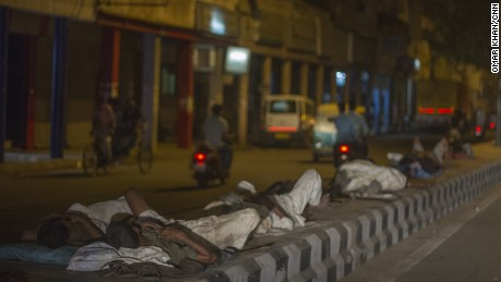 Men sleep on concrete road dividers during a heat wave in Delhi on May 27.
