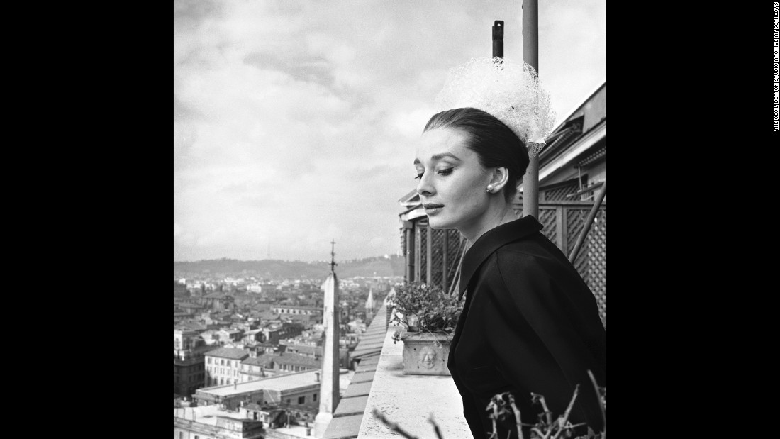 "In 1954, photographer Cecil Beaton praised Hepburn as a new feminine ideal in British Vogue magazine, Trompeteler wrote in an email. When Beaton photographed her on the balcony of the Hassler Hotel in Rome in 1960, he went on to write, ""She has now a new womanly beauty."""