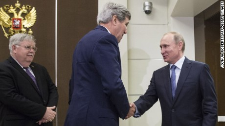 U.S. Secretary of State John Kerry shakes hands with Russia's President Vladimir Putin, next to U.S. Ambassador to Russia John Tefft at the presidential residence Bocharov Ruchey in Sochi.