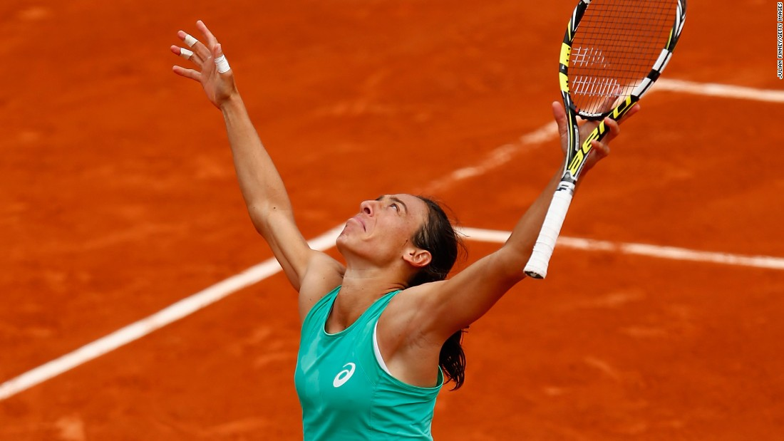 In a battle of French Open champions near the end of their careers, Francesca Schiavone, pictured, outlasted Svetlana Kuznetsova in nearly four hours. Schiavone took the third set 10-8.