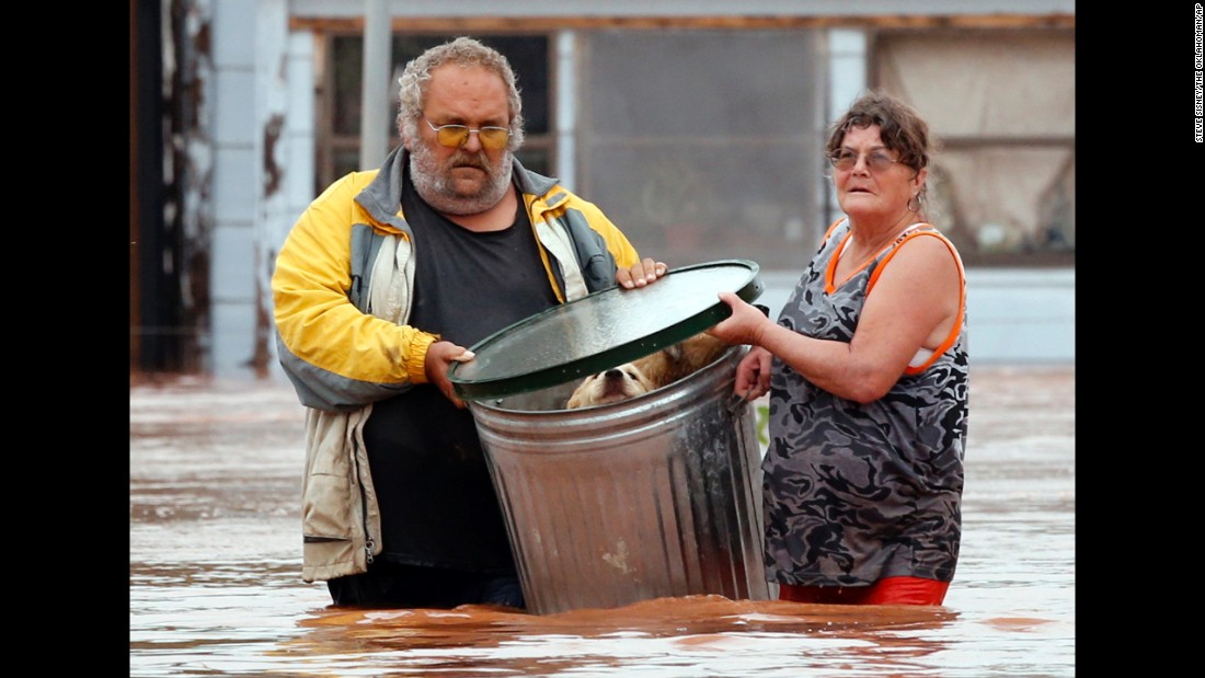 "George and Susan Kruger take some of their animals to safety after the family's home in Purcell, Oklahoma, was flooded on Sunday, May 24.<a href=""http://www.cnn.com/2015/05/24/us/gallery/texas-oklahoma-flash-flood/index.html"" target=""_blank""> Record-setting rains and dangerous storms</a> have been battering Oklahoma and Texas since Memorial Day weekend."