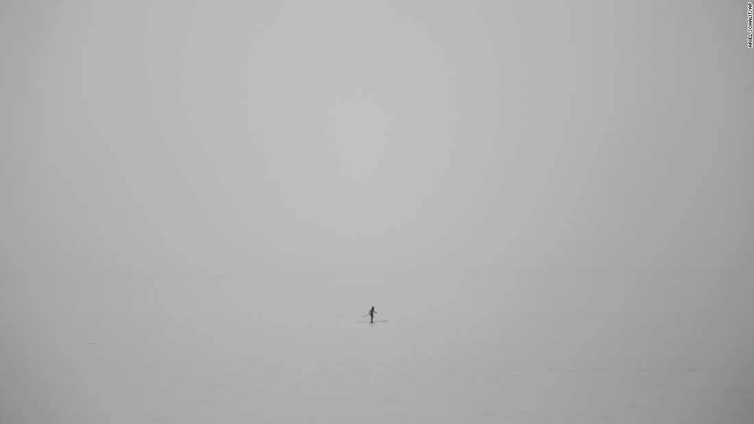 A man stands on his paddleboard Wednesday, May 27, in the Mediterranean Sea near Tel Aviv, Israel.