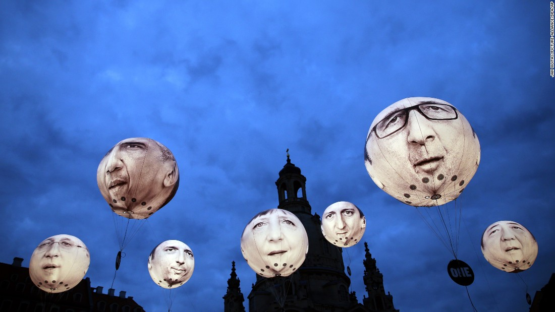 Balloons depicting the leaders of the G-7 nations float in Dresden, Germany, on Wednesday, May 27. From left are Canadian Prime Minster Stephen Harper, U.S. President Barack Obama, Italian Prime Minister Matteo Renzi, German Chancellor Angela Merkel, British Prime Minister David Cameron, French President Francois Hollande and Japanese Prime Minister Shinzo Abe. Finance ministers and central bank leaders from the G-7 are meeting in Dresden this week.