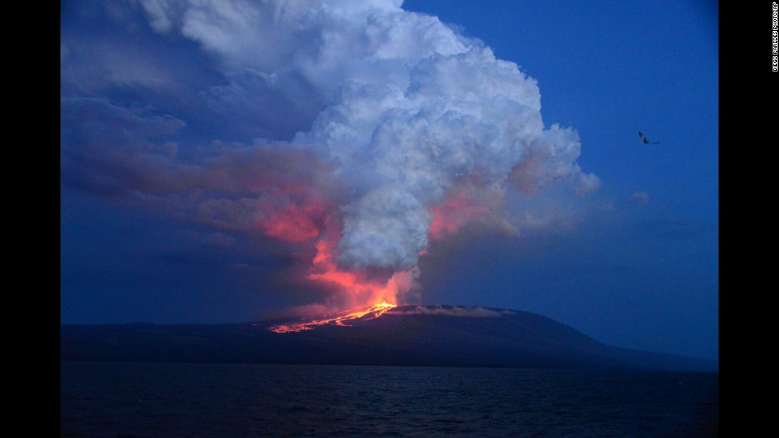 "The Wolf Volcano at Isabela Island -- the largest of the Galapagos Islands west of mainland Ecuador -- <a href=""http://www.cnn.com/2015/05/26/americas/galapagos-volcano-erupts/"" target=""_blank"">erupts</a> Monday, May 25, for the first time in 33 years. <a href=""http://www.cnn.com/2013/11/20/world/gallery/recently-active-volcanos/index.html"" target=""_blank"">See other recently active volcanoes</a>"