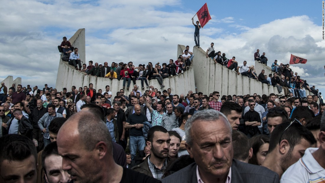 People in Kosovo's capital of Pristina attend a burial ceremony Tuesday, May 26, for eight ethnic Albanians who were killed during fighting with police earlier this month in Kumanovo, Macedonia. Police officers were also killed in the clashes.