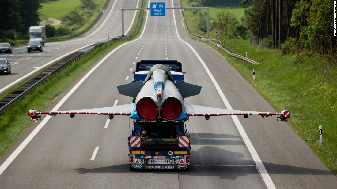 A damaged Eurofighter jet is hauled on the back of a truck near Plech, Germany, on Thursday, May 28.