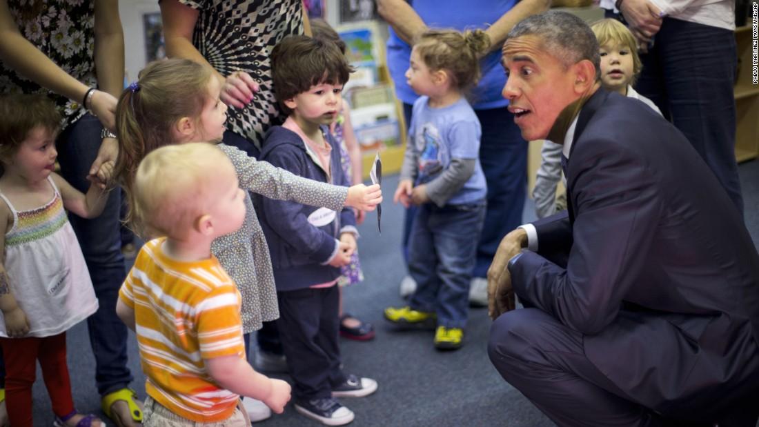 U.S. President Barack Obama talks with children during a visit to a preschool in Washington on Friday, May 22.