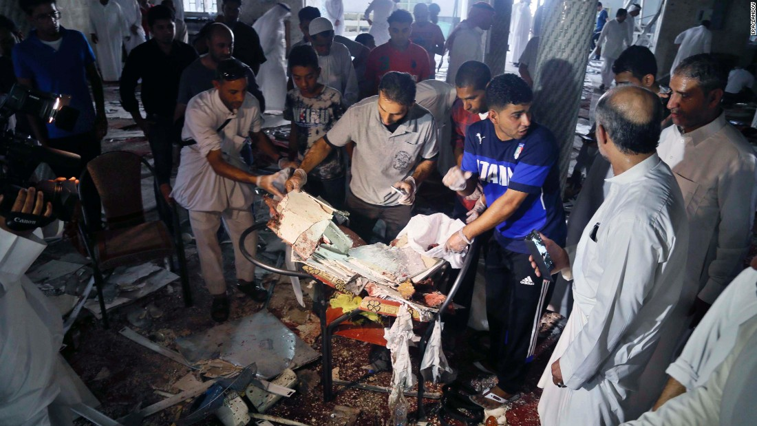 "People search through debris after <a href=""http://www.cnn.com/2015/05/23/middleeast/saudi-arabia-mosque-blast/index.html"" target=""_blank"">an explosion at a Shiite mosque</a> in Qatif, Saudi Arabia, on Friday, May 22. The militant group ISIS claimed responsibility for the attack, which killed 21 people."