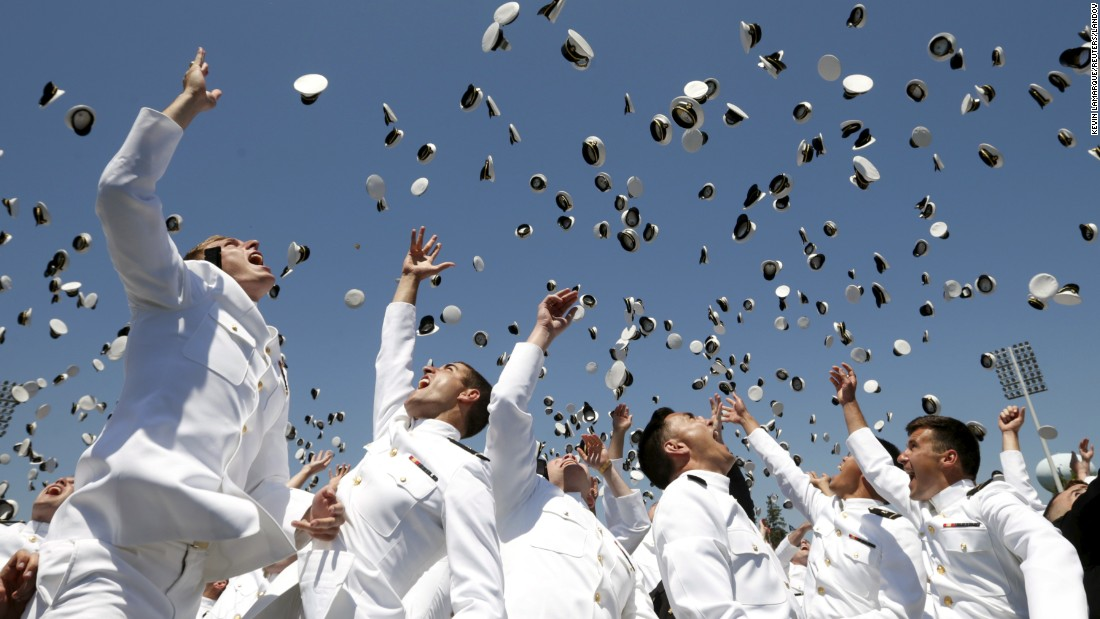 Graduates of the U.S. Naval Academy toss their caps in the air at the end of their commencement ceremony Friday, May 22, in Annapolis, Maryland.