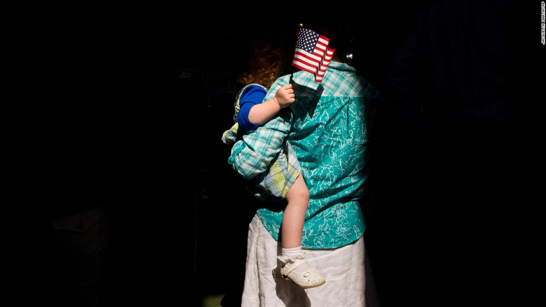 "A woman holds her child in Cabot, Pennsylvania, as they wait for the arrival of former U.S. Sen. Rick Santorum on Wednesday, May 27. <a href=""http://www.cnn.com/2015/05/27/politics/rick-santorum-2016-presidential-announcement/index.html"" target=""_blank"">Santorum announced</a> that he would once again seek the Republican Party's nomination for President."