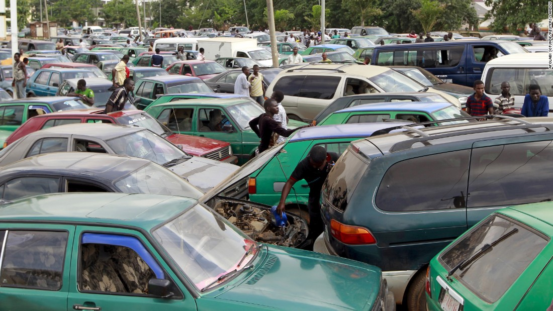 "A man works on his car's engine as motorists gather at a gas station in Abuja, Nigeria, on Monday, May 25. On that day, the nation's petroleum and natural gas association <a href=""http://www.cnn.com/2015/05/25/world/nigeria-shutdown-petrol-subsidies/index.html"" target=""_blank"">suspended a strike</a> that had brought much of the country to a standstill just days before the inauguration of a new President."