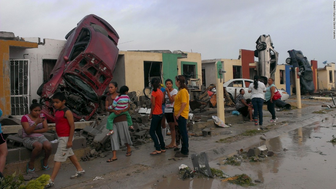"Overturned cars lean against homes after <a href=""http://www.cnn.com/2015/05/25/world/gallery/tornado-mexico/index.html"" target=""_blank"">a tornado hit Ciudad Acuna, Mexico,</a> on Monday, May 25. At least 13 people were killed, authorities said."