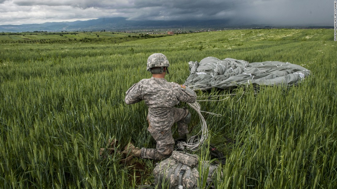 A U.S. paratrooper packs his parachute during a drill in Kosovo on Wednesday, May 27.