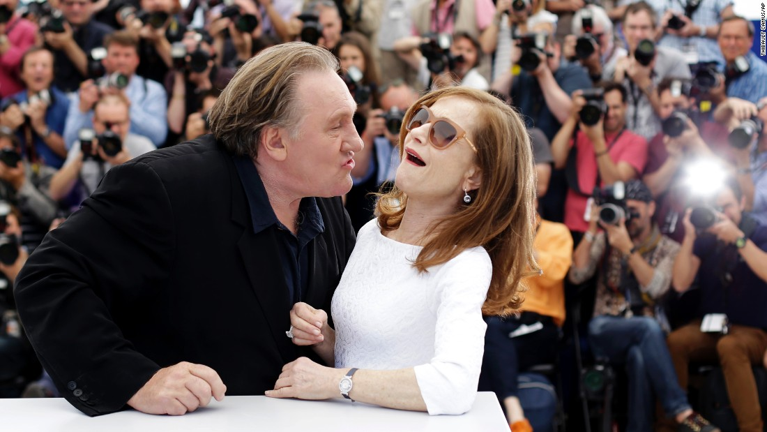 "Actor Gerard Depardieu tries to kiss actress Isabelle Huppert on Friday, May 22, during a photo call for the movie ""Valley of Love"" at the Cannes Film Festival in France."