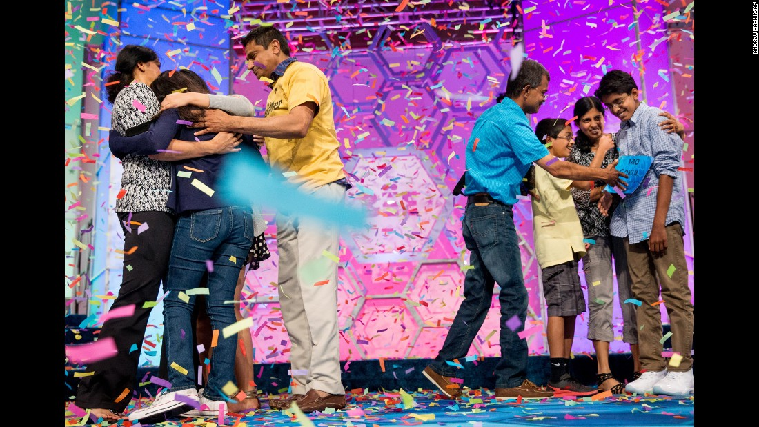 "Vanya Shivashankar, second from left, and Gokul Venkatachalam, far right, are greeted onstage by their families on Thursday, May 28, after <a href=""http://www.cnn.com/2015/05/28/living/national-spelling-bee/index.html"" target=""_blank"">they were named co-champions</a> of the Scripps National Spelling Bee in Oxon Hill, Maryland. Vanya, who is from Olathe, Kansas, correctly spelled the word ""scherenschnitte."" Gokul, from Chesterfield, Missouri, correctly spelled the word ""nunatak."" <a href=""http://www.cnn.com/2015/05/27/living/gallery/faces-of-2015-national-spelling-bee/index.html"" target=""_blank"">See the faces of the 2015 National Spelling Bee</a>"