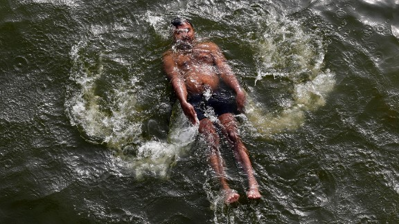 A man swims in the River Yamuna in Allahabad, India, on May 27.