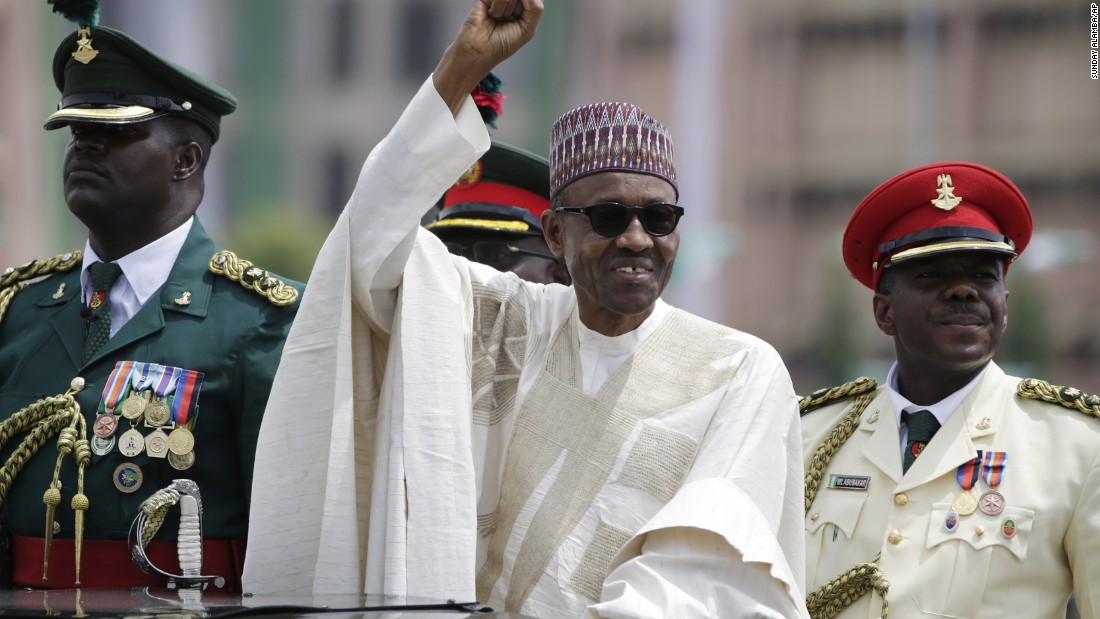 "New Nigerian President Muhammadu Buhari salutes supporters during his inauguration in Abuja, Nigeria, on Friday, May 29. The ceremony marked <a href=""http://www.cnn.com/2015/05/29/africa/nigeria-buhari-sworn-in/"" target=""_blank"">the first peaceful transfer of power between rival parties</a> in the African nation."