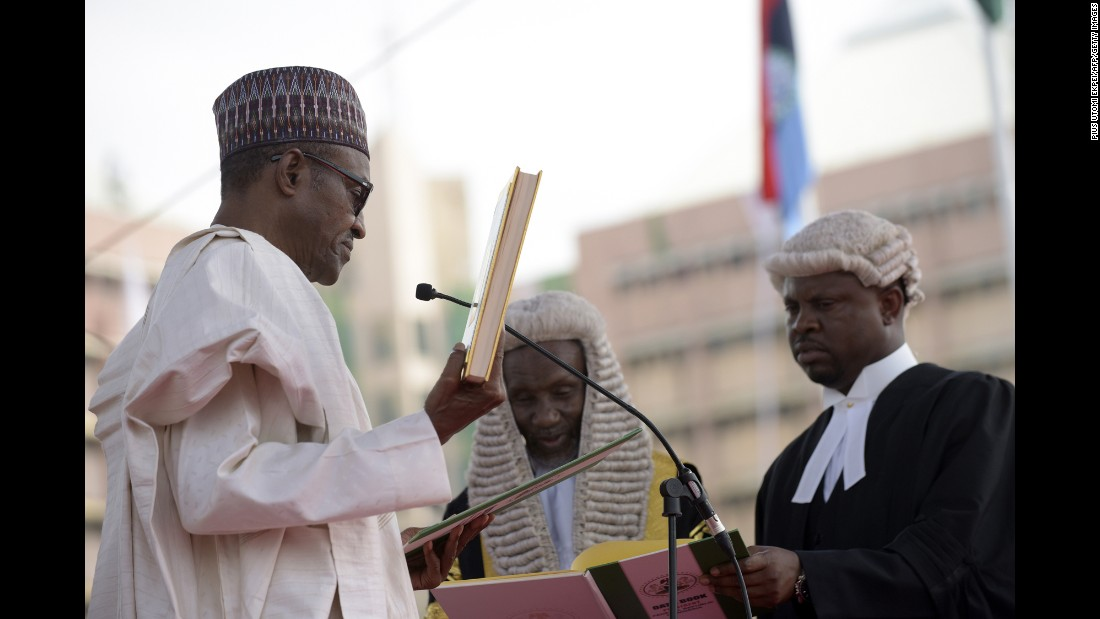 Buhari takes the oath of office at Eagle Square in Abuja on May 29.