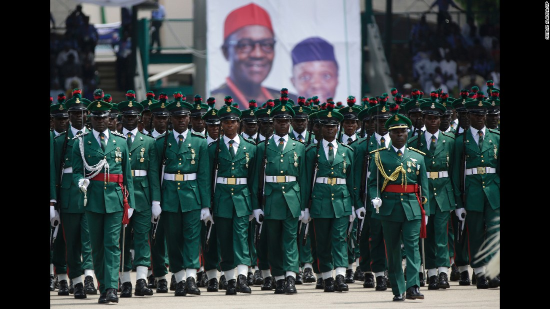 Nigerian soldiers parade during the inauguration ceremony.