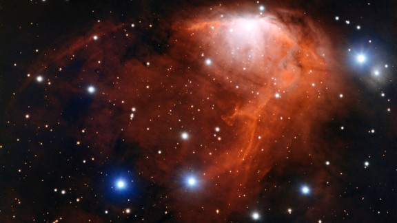 This nebula, or cloud of gas and dust, is called RCW 34 or Gum 19. The brightest areas you can see are where the gas is being heated by young stars. Eventually the gas burst outward like champagne after a bottle is uncorked. Scientists call this champagne flow. This new image of the nebula was captured by the European Space Organization
