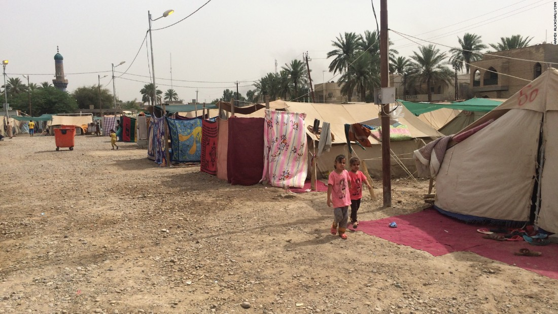 The camp is situated on what was a parking lot for the local Sunni mosque in the Baghdad neighborhood of al-Jamiaa.