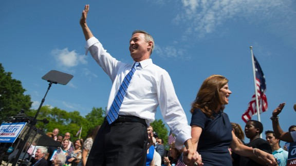 Former Maryland Gov. Martin O'Malley waves as he arrives with his wife Katie O'Malley to an event to announce that he is entering the Democratic presidential race, on Saturday, May 30, 2015, in Baltimore