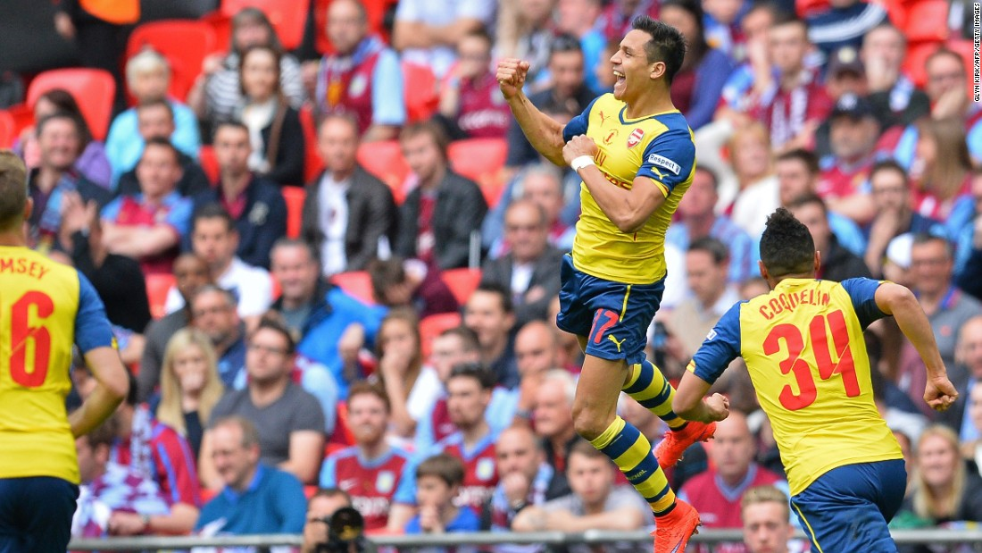 High flyer: Alexis Sanchez goes airborne after scoring a spectacular second goal for Arsenal in the final at Wembley.