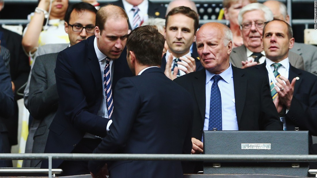 FA president and Aston Villa fan Prince Williams hands out the runners-up medal to the club's manager Tim Sherwood.
