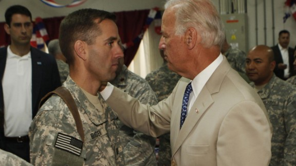 Vice President Joe Biden  talks with his son, U.S. Army Capt. Beau Biden at Camp Victory on the outskirts of Baghdad on July 4, 2009.