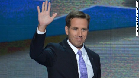 Attorney General of Delaware and son of Vice President Joe Biden, Beau Biden, waves to the audience at the Time Warner Cable Arena in Charlotte, North Carolina, on September 6, 2012 on the final day of the Democratic National Convention (DNC). US President Barack Obama is expected to accept the nomination from the DNC to run for a second term as president. AFP PHOTO Stan HONDA (Photo credit should read STAN HONDA/AFP/GettyImages)