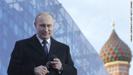 Russia's President Vladimir Putin reacts as he gives a speech during a rally and a concert by the Kremlin Wall in central Moscow on March 18, 2015.