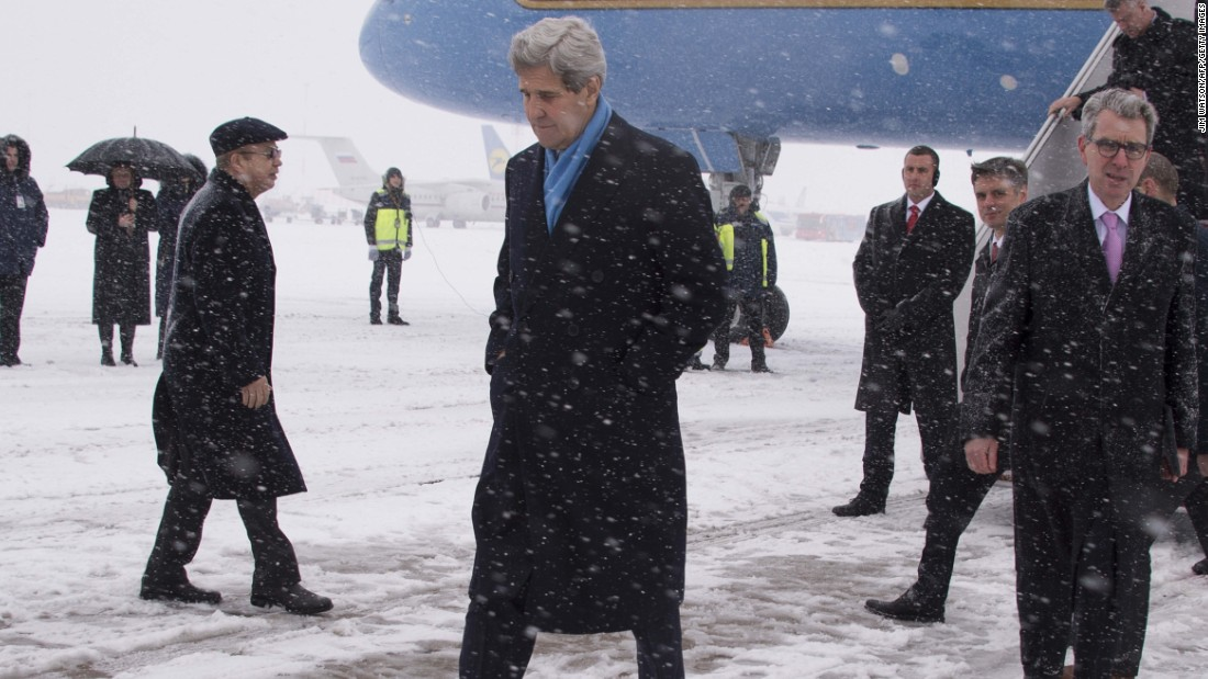 Kerry walks off the plane at Kiev Boryspil International Airport in Kiev, Ukraine, on February 5.  His visit came as international pressure grew for an immediate halt to surging violence.