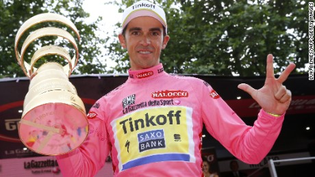 Alberto Contador clutches the winning trophy at the 2015 Giro d'Italia - his second victory in the race.