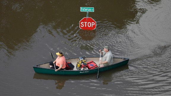 People canoe through floodwaters in Houston on Saturday, May 30.  Torrential rains have given Texas the wettest month on record, according to Texas A&M climatologists. In all, 37.3 trillion gallons of water have fallen over the state in May, the National Weather Service said.