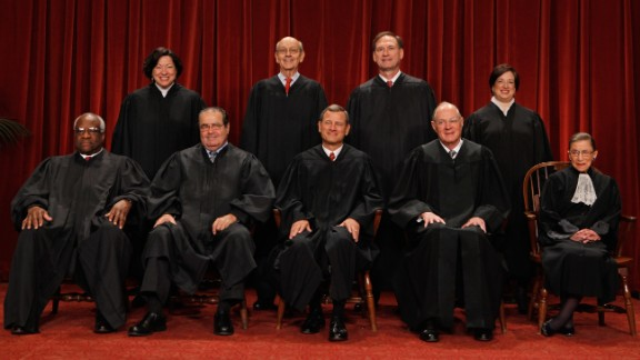 WASHINGTON - OCTOBER 08:  U.S. Supreme Court members pose for photographs in the East Conference Room at the Supreme Court building October 8, 2010 in Washington, DC. This is the first time in history that three women are simultaneously serving on the court.