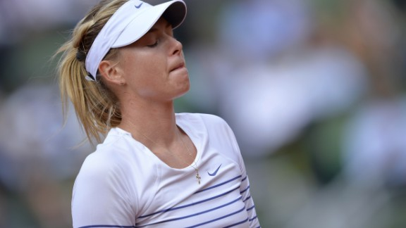 It was that kind of a day for Maria Sharapova. The defending champion fell in straight sets to Lucie Safarova.