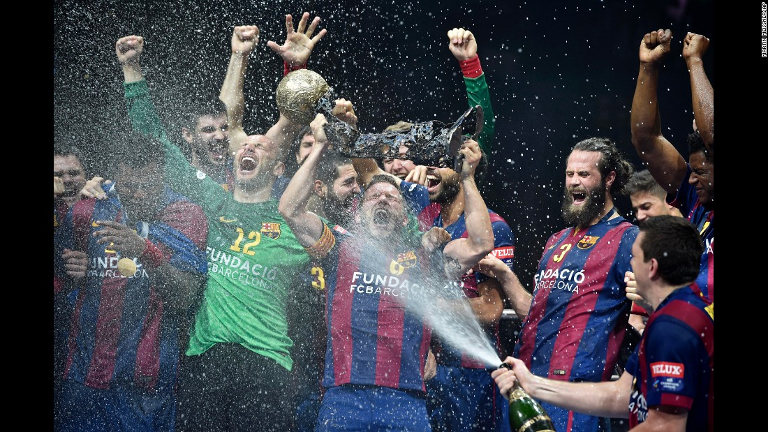 FC Barcelona's handball team celebrates after winning the Champions League final Sunday, May 31, in Cologne, Germany. No team has won the European tournament more than Barcelona. This was its ninth title since 1991.