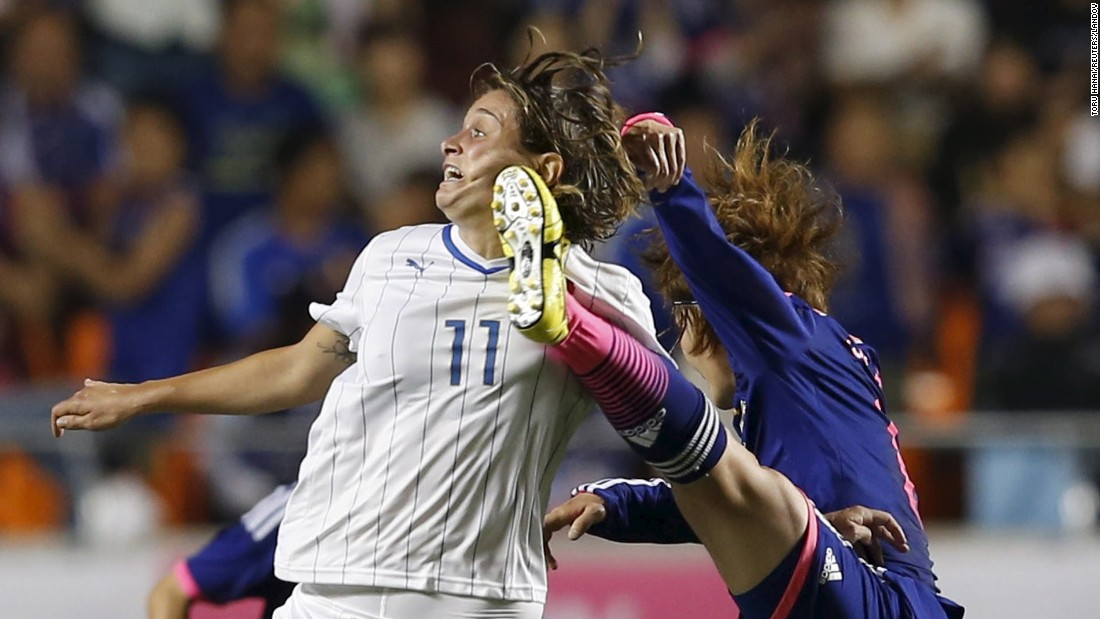 Japan's Mizuho Sakaguchi, right, and Italy's Cristiana Girelli compete for the ball during an international friendly match played Thursday, May 28, in Nagano, Japan. The Women's World Cup begins Saturday, June 6. Japan won the last tournament in 2011.