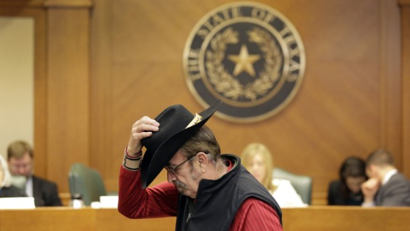 Jerry Williams finishes giving testimony at a hearing on the gun bill last week in Austin, Texas. More than 100 people waited under heightened security at the Capitol to testify.