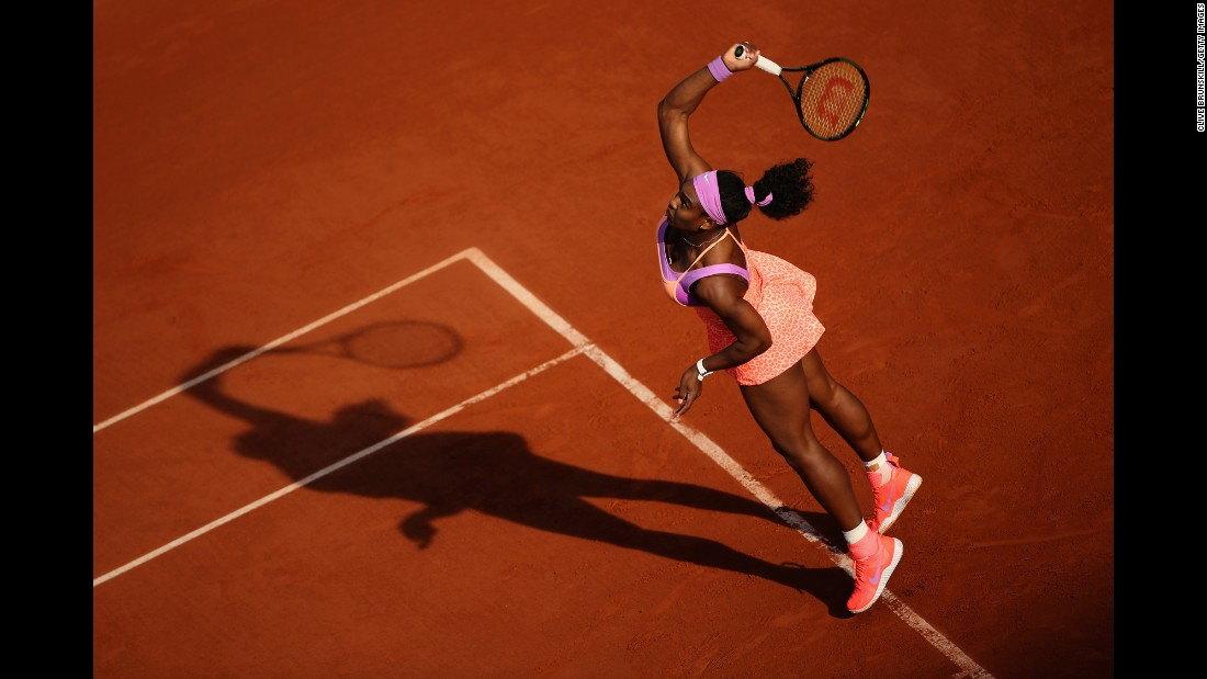 Serena Williams serves to Victoria Azarenka in the third round of the French Open on Saturday, May 30. Williams, the world's top-ranked player, advanced to the next round with a three-set victory.