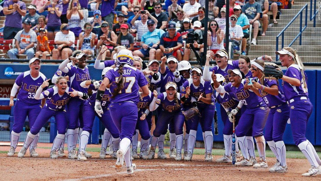 LSU softball player Kellsi Kloss runs to home plate, where her teammates were waiting for her, after a home run in the College World Series on Thursday, May 28.