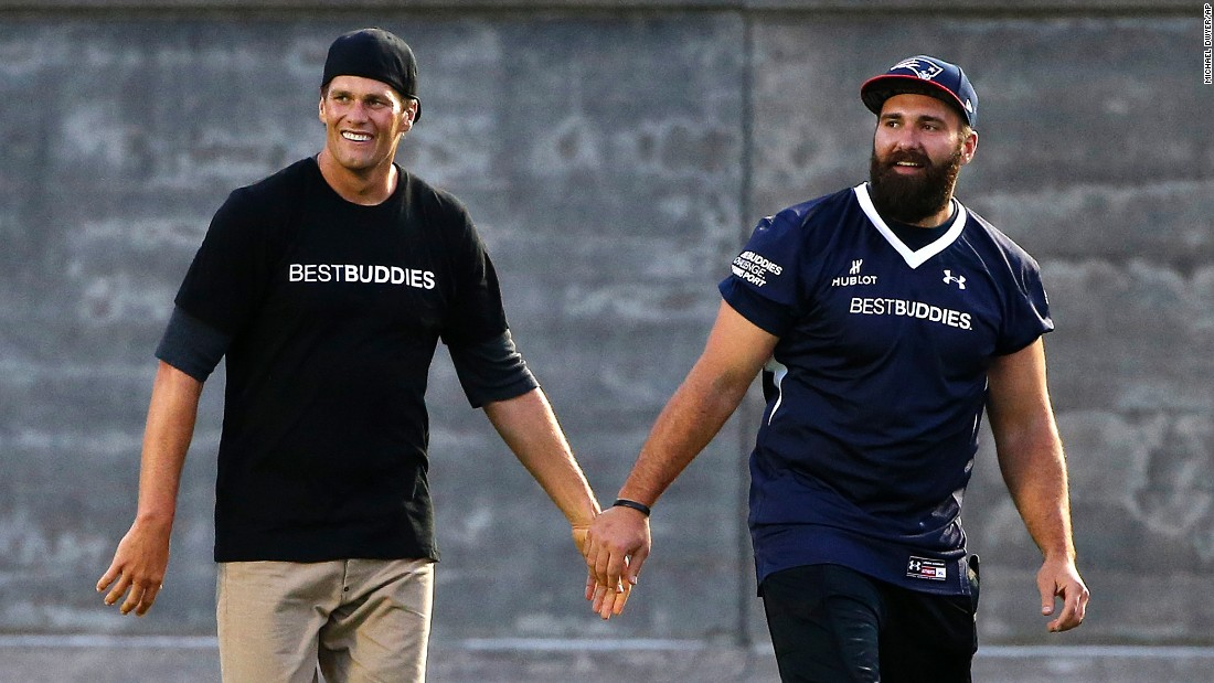 Tom Brady, left, and New England teammate Rob Ninkovich walk together after playing in a Best Buddies charity football game Friday, May 29, in Boston.