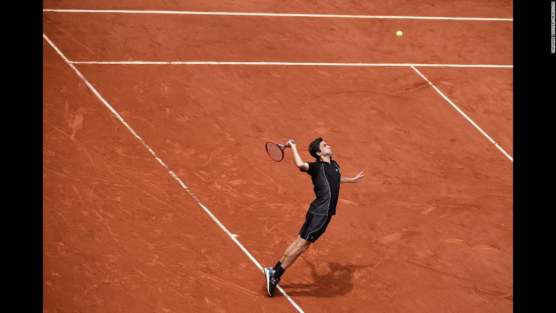 Gilles Simon serves to Nicolas Mahut during the third round of the French Open on Friday, May 29. In a battle of two Frenchmen, Simon advanced with a hard-fought five-set victory.