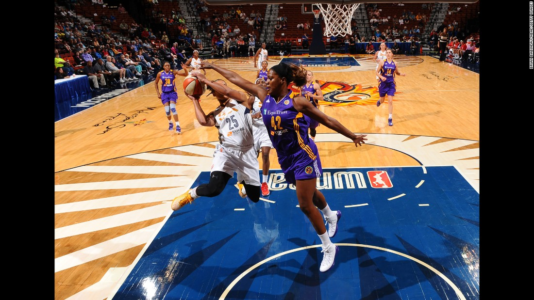 Jantel Lavender of the Los Angeles Sparks defends Alyssa Thomas of the Connecticut Sun during a WNBA preseason game in Uncasville, Connecticut, on Thursday, May 28.