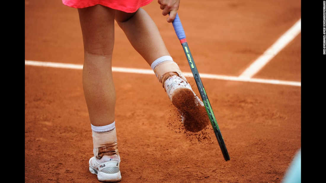 Marina Erakovic knocks clay off her shoes during her first-round match at the French Open on Tuesday, May 26.