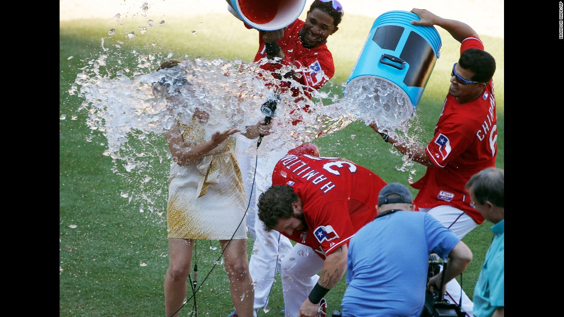 "Texas outfielder Josh Hamilton and TV reporter Emily Jones are doused with Powerade by Hamilton's teammates Elvis Andrus, top, and Robinson Chirinos during a postgame interview on Sunday, May 31. Jones <a href=""https://twitter.com/EmilyJonesMcCoy/status/605184671224242176"" target=""_blank"">promised revenge</a> on Twitter. <a href=""http://www.cnn.com/2015/05/26/sport/gallery/what-a-shot-sports-0525/index.html"" target=""_blank"">See 40 amazing sports photos from last week</a>"