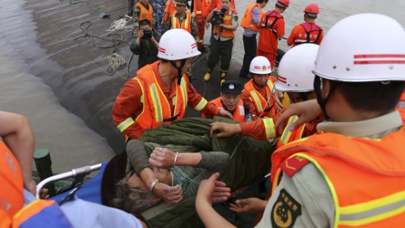 A survivor is carried onto the riverbank after being rescued on June 2.
