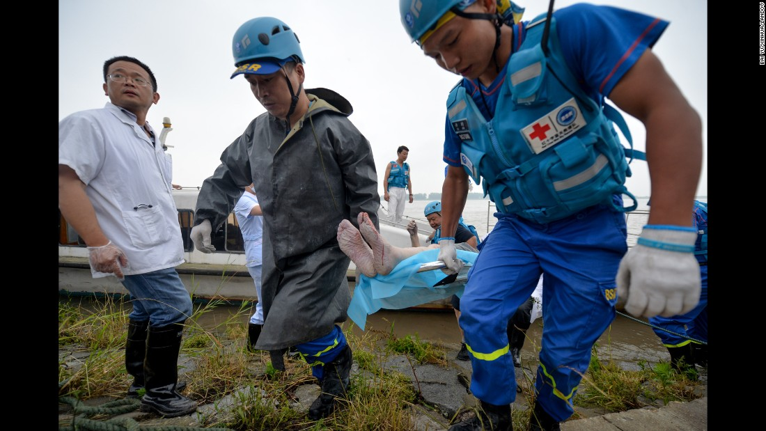 The body of a victim is brought onto the shore on June 2.